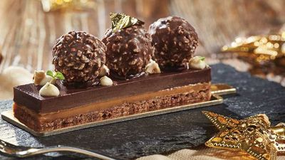 """<a href=""""http://kitchen.nine.com.au/2016/12/15/12/37/the-rocher-delight-bar-with-salted-caramel-and-hazelnut-ganache"""" target=""""_top"""">The Rocher delight bar with salted caramel and hazelnut ganache</a>"""