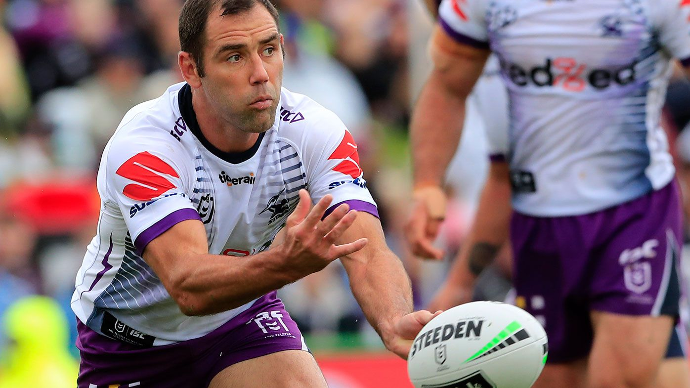 Cameron Smith of the Storm passes the ball during the round 1 NRL match between the Manly Sea Eagles and the Melbourne Storm
