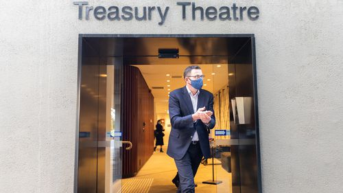 Premier of Victoria Daniel Andrews wearing a mask walks out of the theatre hall after his press conference on July 24, 2020 in Melbourne.