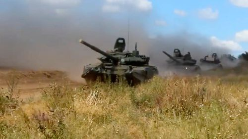 Russian tanks speed across the plains in Siberia.