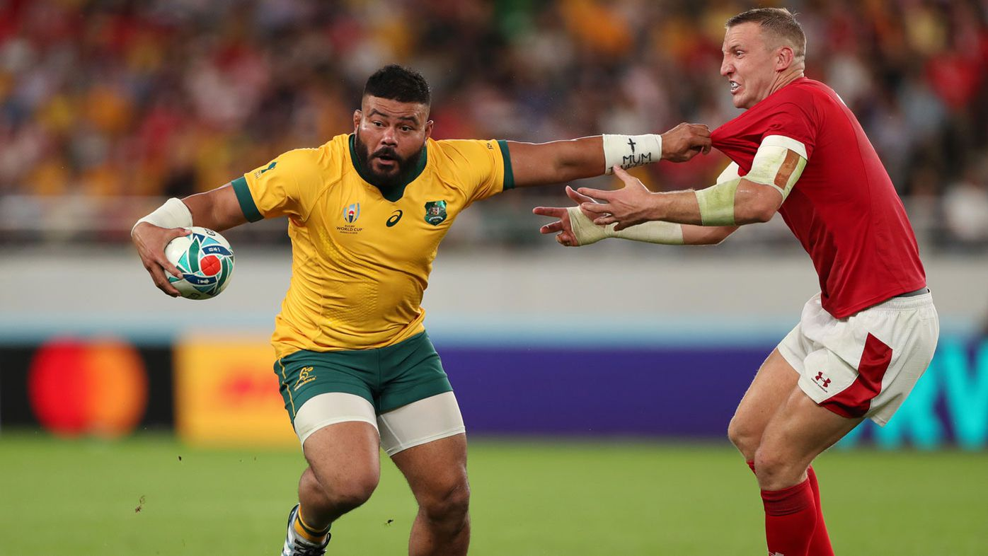 Tolu Latu of Australia holds off Hadleigh Parkes of Wales during the Rugby World Cup 2019