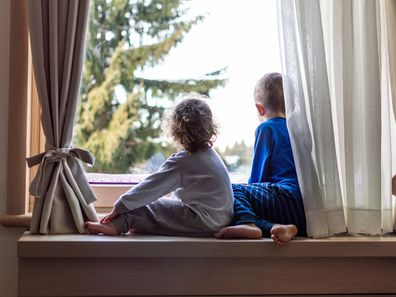 Two children at window