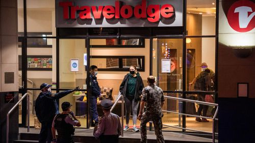 Returned travellers being moved from the Travelodge in Surry Hills last night.