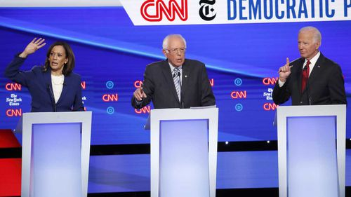 Kamala Harris, Bernie Sanders and Joe Biden all vie for attention in the Democratic debate.