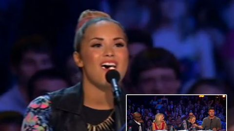 Watch: Demi Lovato spits mints at Simon Cowell