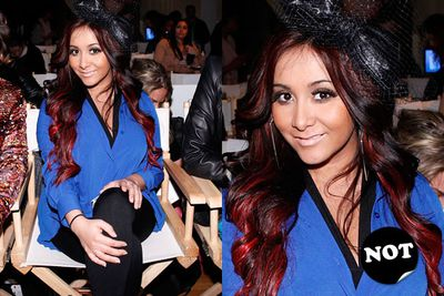 You'd think being Fashion Week and all, Snooki would have made a special effort to hold off on the orange tinge. Apparently not.