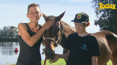 Bec Winter and her son Riley with Charmers, the horse who she rode to safety during the 2019/20 bushfire season.