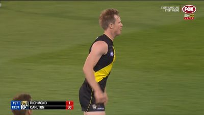 Tigers open AFL with tough win over Blues