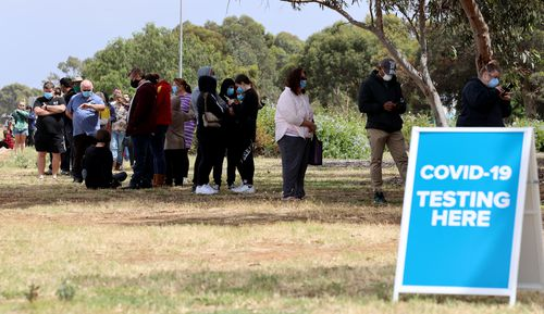 People queuing at the COVID-19 testing site at Parafield Airport