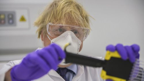 Britain's Prime Minister Boris Johnson visits the French biotechnology laboratory Valneva in Livingston, Scotland, Thursday Jan. 28, 2021, where they will be producing a COVID-19 vaccine on a large scale, during a visit to Scotland.