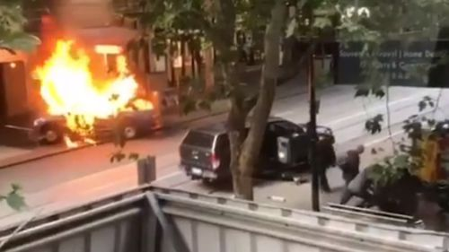 The car erupted in flames shortly before the man continued attack on police.