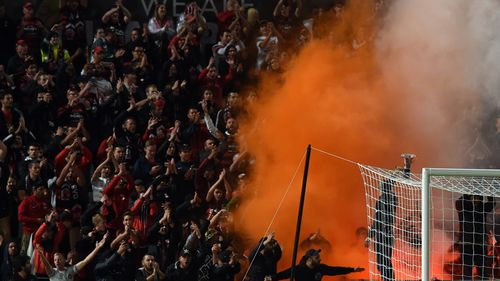 The clashes started after a flare was set off among Wanderers fans in the grandstand at Pirtek Stadium in Parramatta. (AAP)