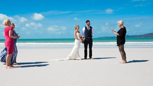 Alyssia and Curtis Fisher eloped on Whitehaven beach to have a post Cyclone wedding. (Photo: Tropix Photography)
