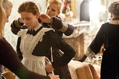 Amy Nuttall (Ethel Parks) has her maid's outfit tended to between takes.