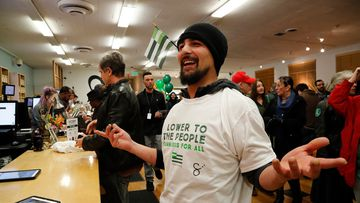 An ecstatic customer after making a purchase and wearing his free t-shirt at the Harborside cannabis dispensary in Oakland, California. (AAP)