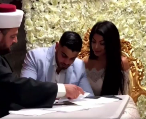 The couple ties the knot at the Merrylands home. (9NEWS)