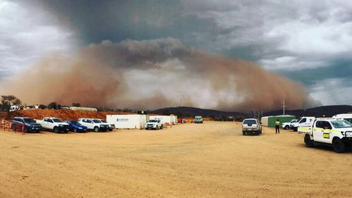 As the thunderstorms developed, winds stirred up dust over dry, rural areas around Broken Hill and turned the sky red.