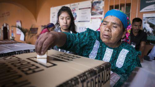 Women of the 'zapoteca' community arrive to vote, in Oaxaca, Mexico