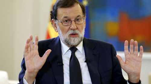 Spanish PM Mariano Rajoy during a TV interview. (AAP)