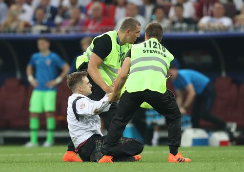 Four Two people stormed on to the pitch in the 52nd minute of the game between France and Croatia. Picture: AAP
