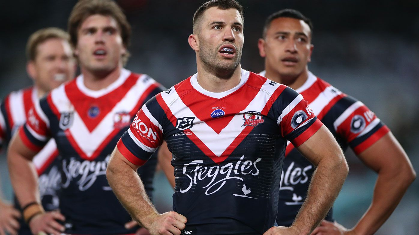 Sydney Roosters players look on in their historic loss to the Rabbitohs.
