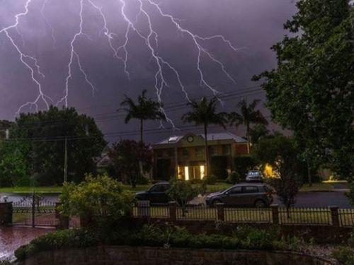 Lightning hits above a home in East Killara, in Sydney's north (Insgram: @dan.seto)