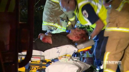 Crews worked for an hour to free the front seat passenger who became trapped in the wreckage of the crash. (9NEWS)