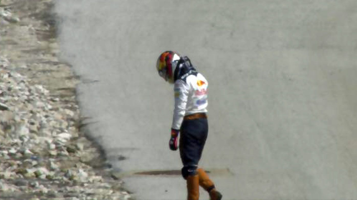 Daniel Ricciardo dejected on the track after retiring