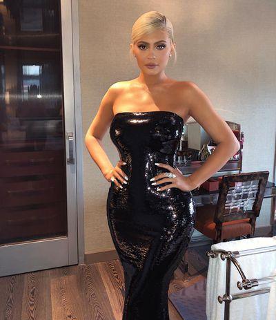 Kylie channels her inner black swan in figure-hugging black latex dress.