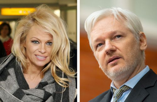 Pamela Anderson, pictured with Julian Assange, says she believes Assange is in danger. (AAP)