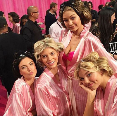 First-time Angel Gigi Hadid poses with her fellow angels backstage. (Instagram/@devwindsor)