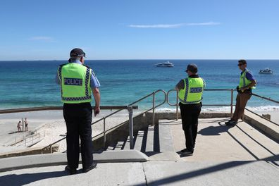 Police officers patrol Cottesloe Beach on April 10, 2020 in Perth, Australia.
