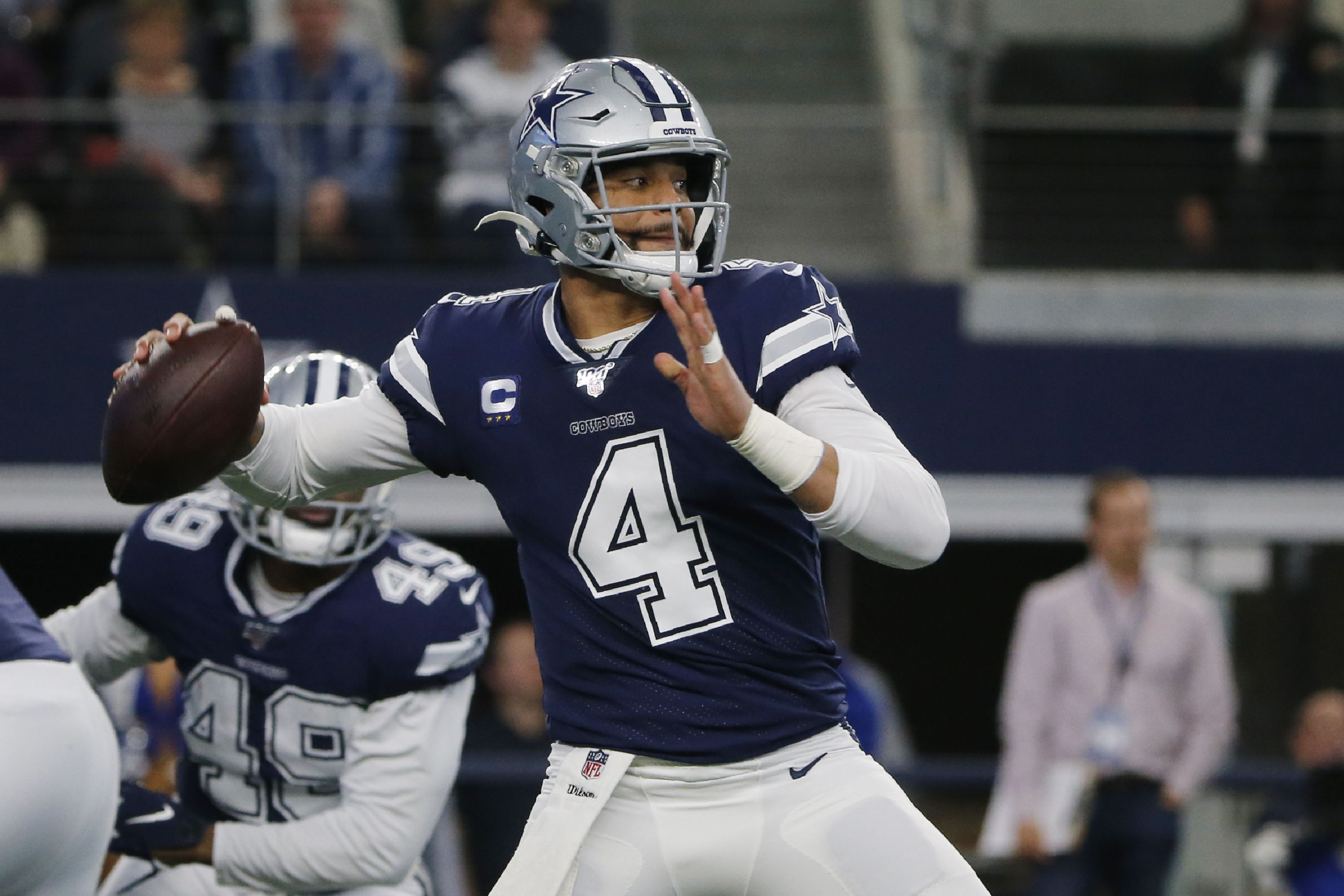 Dallas Cowboys quarterback Dak Prescott looks to throw.