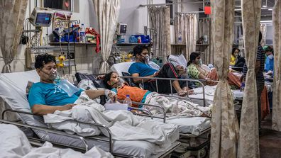 Patients inside the emergency ward of a COVID-19 hospital in New Delhi, India.