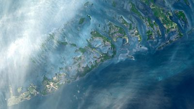 """The Florida Keys are a chain of islands, islets and reefs extending from Virginia Key to the Dry Tortugas for about 309 km. The keys are chiefly limestone and coral formations."" (NASA/METI/AIST/Japan Space Systems, and U.S./Japan ASTER Science Team)"