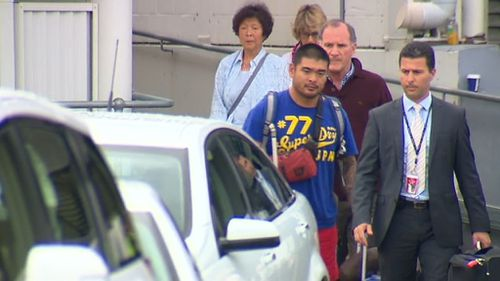 The Chan family pictured arriving in Sydney this morning. (9NEWS)