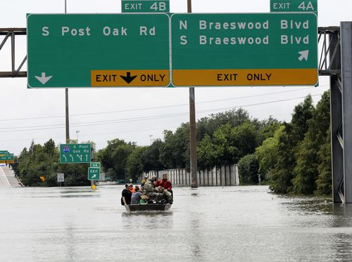 Residents are rescued from their homes surrounded by floodwaters in Houston. (AP)