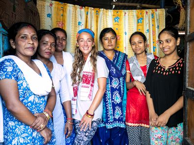 Samantha with a group of locals she met along her journey.