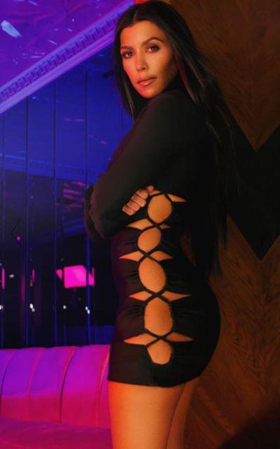 "<a href=""https://www.prettylittlething.com.au/black-bandage-lace-up-high-neck-bodycon-dress.html"" target=""_blank"">Black bandage lace up high neck bodycon dress, $90.</a>"