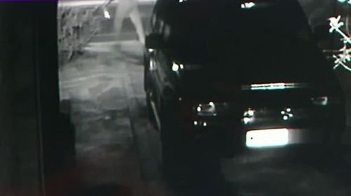 In CCTV from the Seaton house, a person is seen pouring petrol on the 4WD before lighting it on fire. (9NEWS)