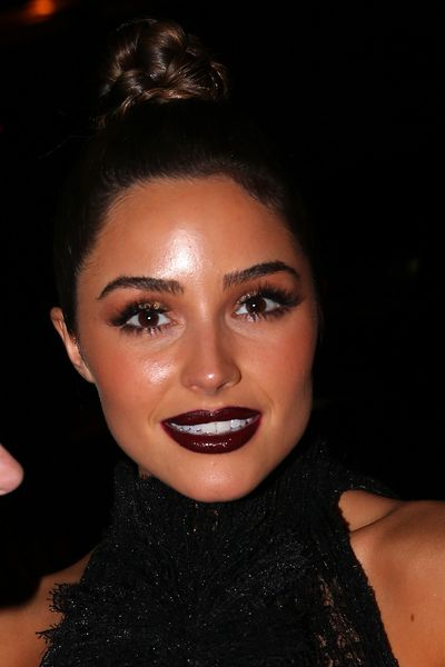 Actress Olivia Culpo in rich plum. A yes.