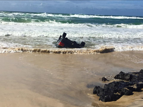 High tide prevented efforts to recover the four-wheel drive on Tuesday. (Queensland Ambulance Service)