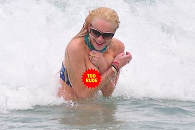 Lindsay Lohan flashed a little too much boob while body surfing in Miami... awks!