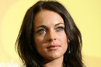 """Lindsay's Tinseltown dream started to unravel around 2006. While filming <i>Georgia Rule</i>, Lindsay was hospitalised with her representative blaming """"exhaustion and overheating"""".<br/>A studio executive was so livid he threatened legal action, and released a letter calling her """"irresponsible and unprofessional"""", saying: """"We are well aware that your ongoing all-night heavy partying is the real reason for your so called 'exhaustion'. We refuse to accept bogus excuses for your behaviour""""."""
