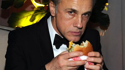 January 12, 2014: Christoph Waltz also enjoying the free food on offer at the The Weinstein Company after party at the Beverly Hilton Hotel. <br><br> Photo by Angela Weiss, Getty Images for TWC.