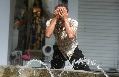 Locals in Spain are flocking to water sources to escape the heat. Image: AAP