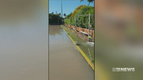 The burst water main caused chaos in Greenslopes as it caused significant damage to furniture, bowling greens and the street. Picture: 9NEWS.