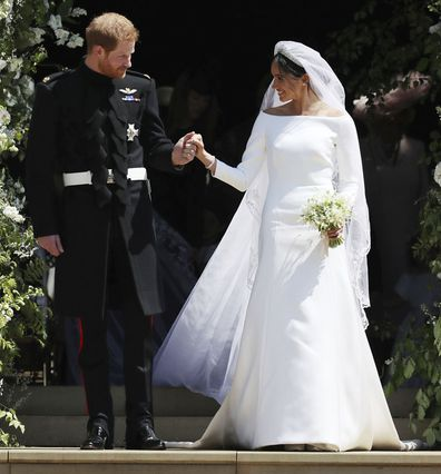 Meghan Markle and Britain's Prince Harry walk down the steps of St George's Chapel at Windsor Castle in Windsor, near London, England, following their wedding.