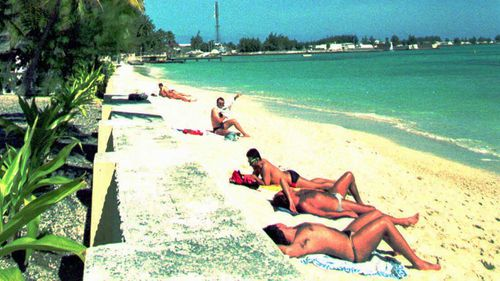 French soldiers soak up the sun at the Mururoa Atoll.