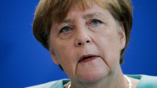 Defiant Merkel defends refugee stance after attacks